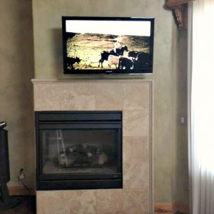 TV mount over fireplace in Fort Collins